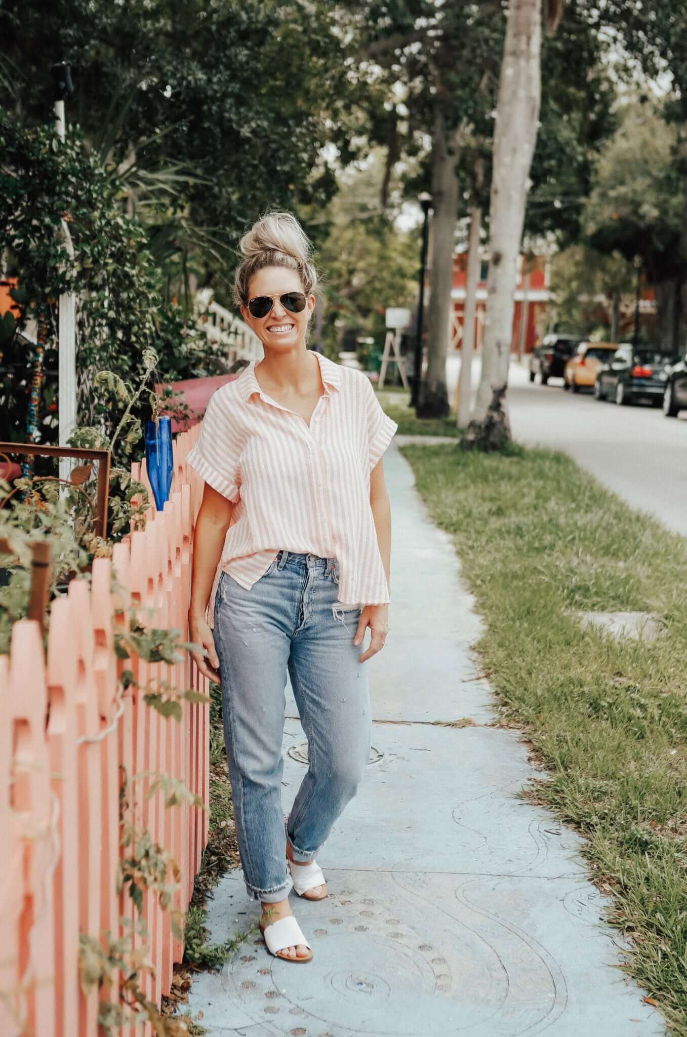 blush and stripes in a top on a girl in a park