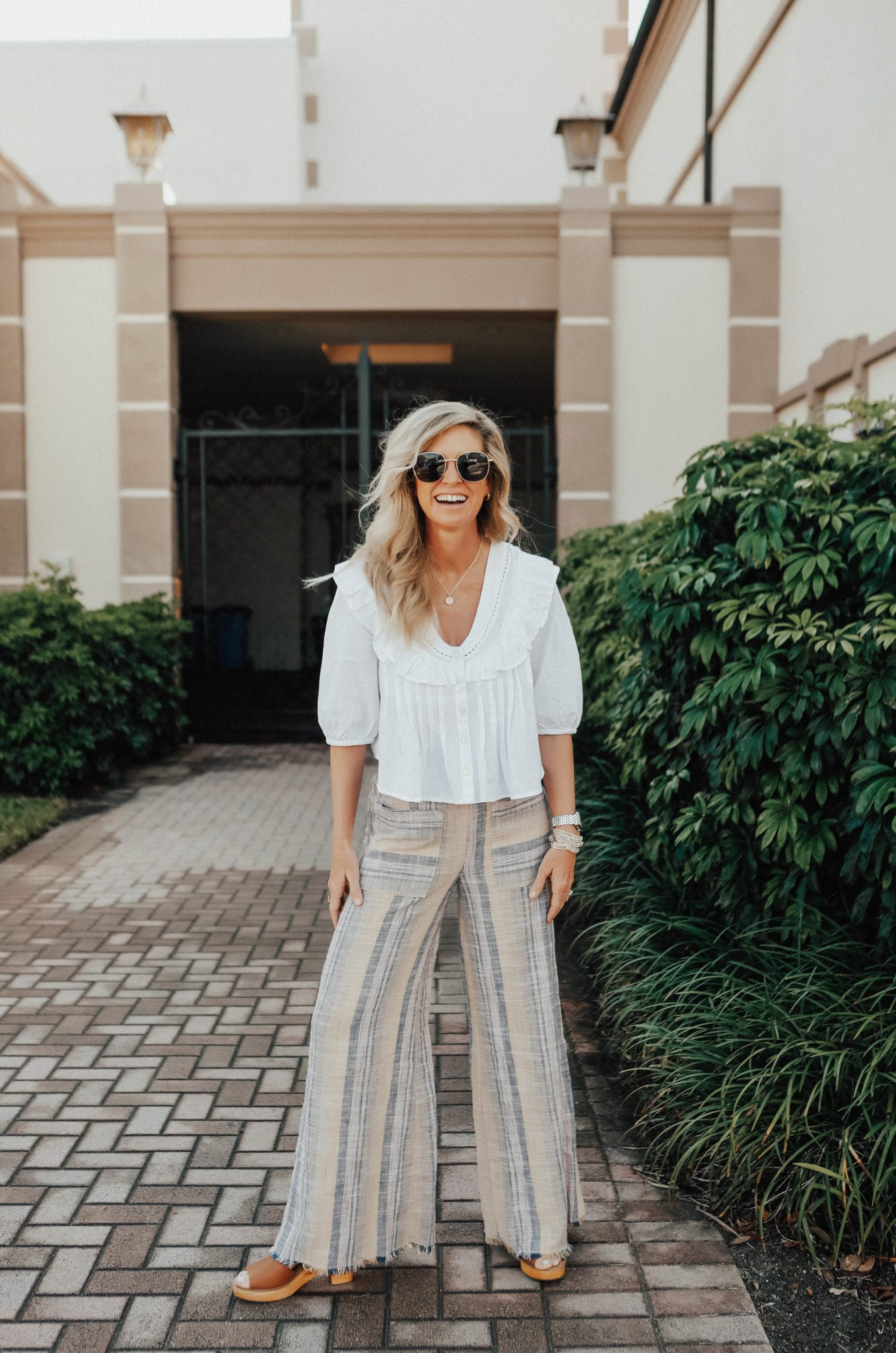 White top paired with palazzo pants