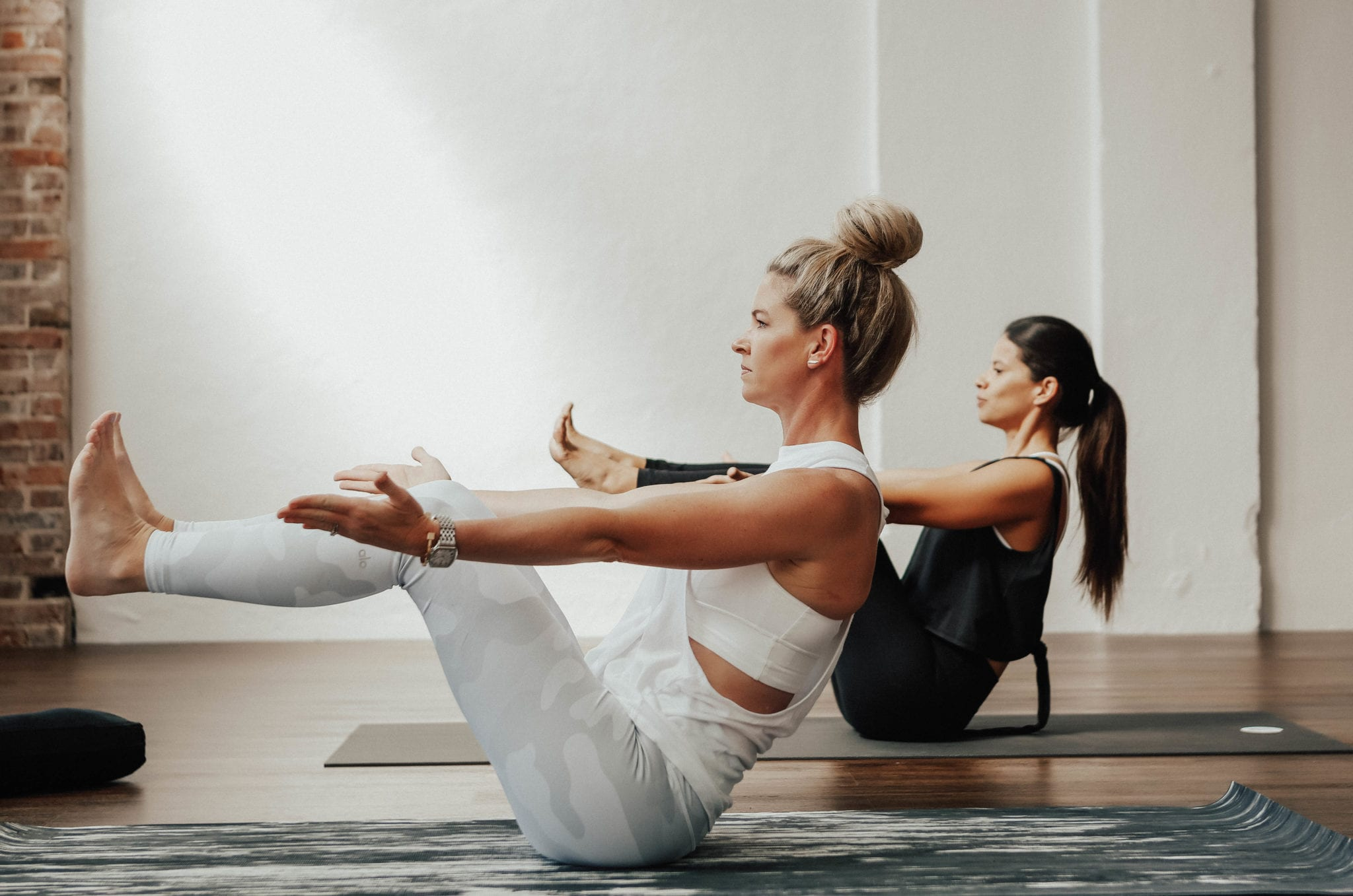 Mandy Cox is wearing a white Alo Yoga Top and Pants